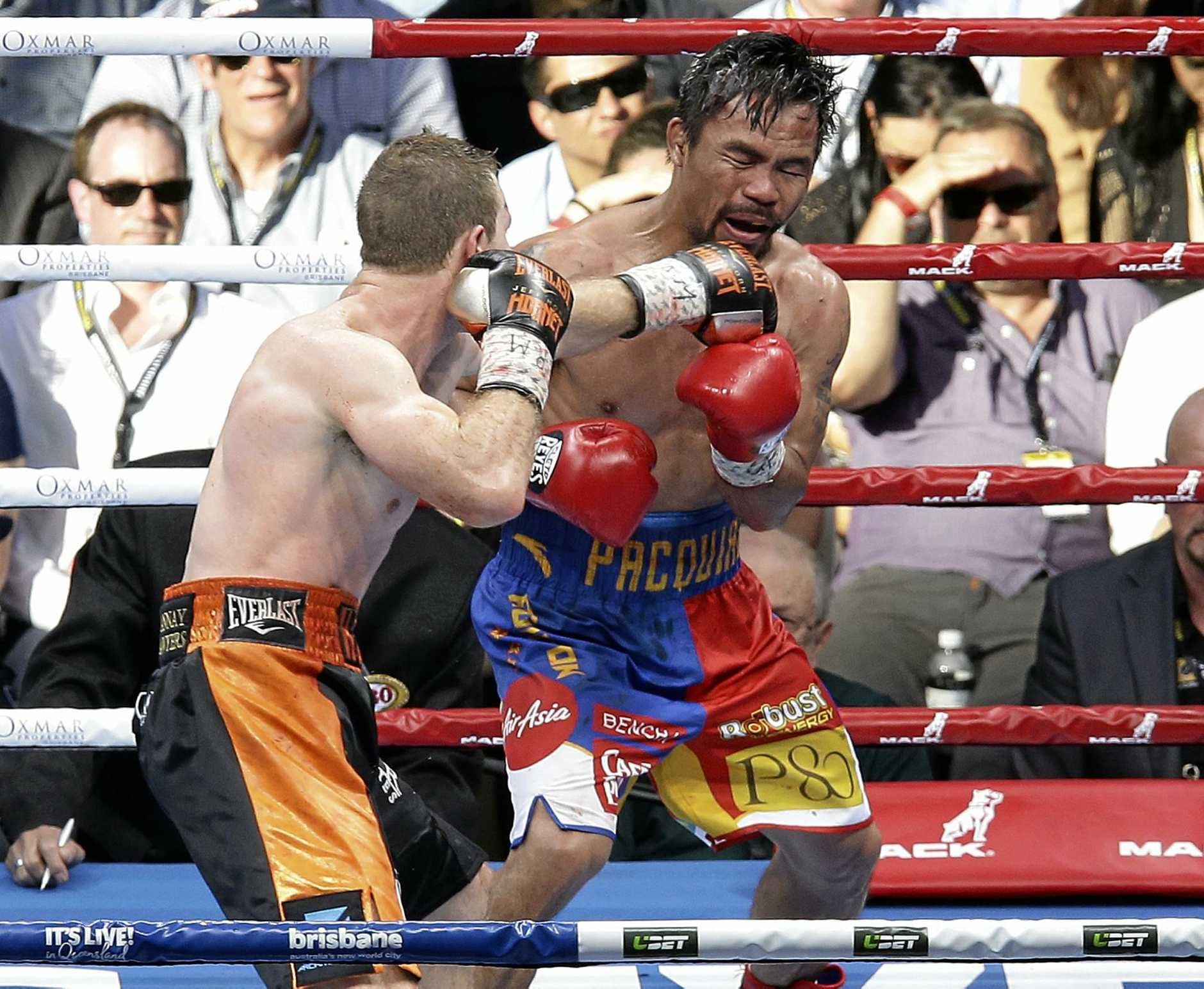 Manny Pacquiao (right) of the Philippines and Australia's Jeff Horn of Australia fight during their WBO World welterweight title bout in Brisbane.