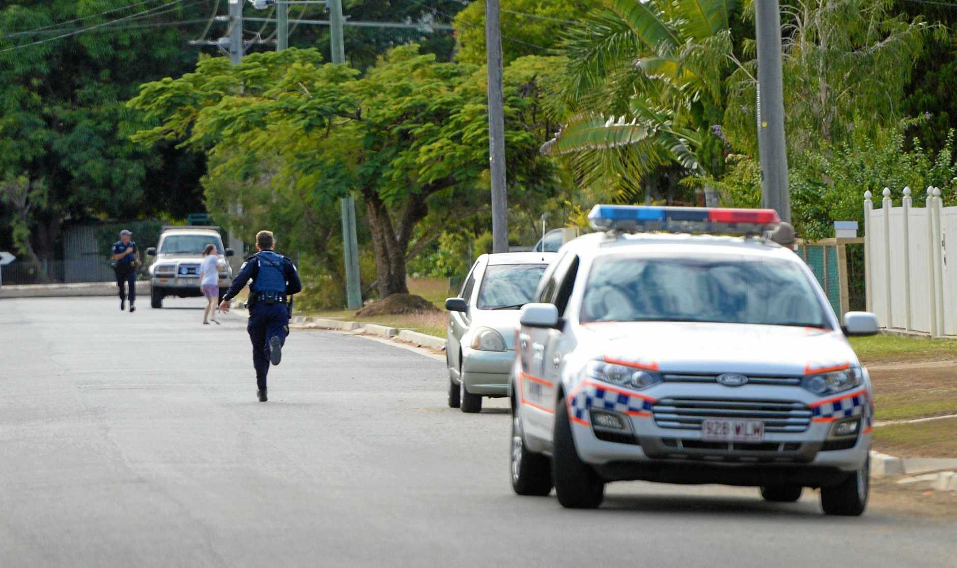 Police officers run to recapture a man who escaped custody in handcuffs on Thackeray Street Park Avenue.