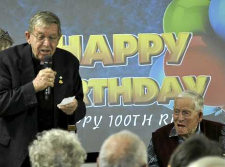 Rex Turnbull's son Ian (left) shares stories at his father's birthday celebrations.
