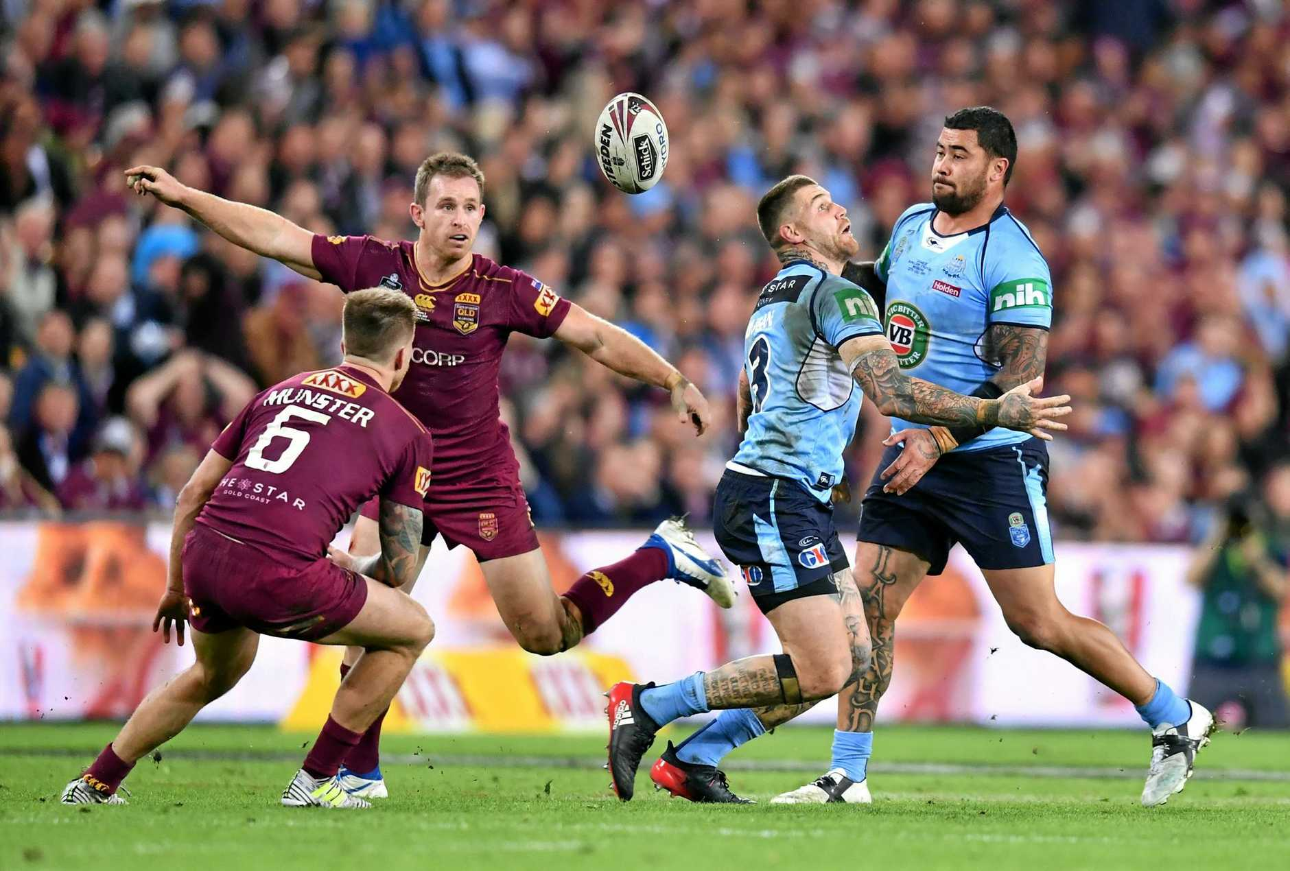 Josh Dugan  (second from right) of the Blues loses the ball in the tackle of Cameron Munster (left) and Michael Morgan  (second from left) of the Maroons during State of Origin game 3 between the Queensland Maroons and the New South Wales Blues at Suncorp Stadium in Brisbane, Wednesday, July 12, 2017.  (AAP Image/Darren England) NO ARCHIVING, EDITORIAL USE ONLY.