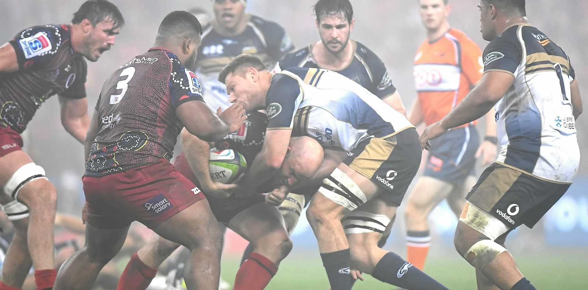 HARD YARDS: Queensland Reds prop Stephen Moore takes on the ACT Brumbies defence during their round 16 Super Rugby victory.