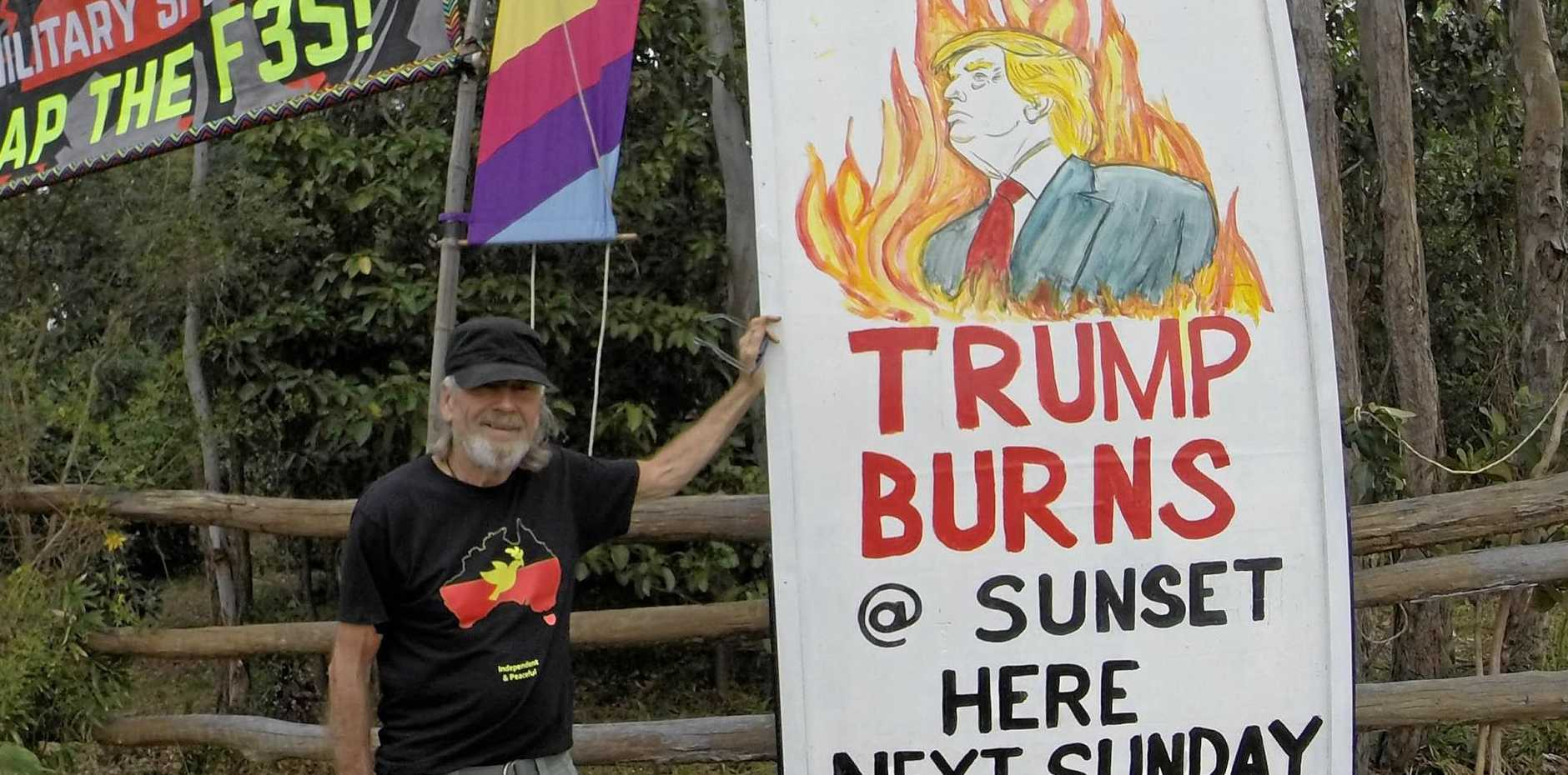 Graeme Dunstan with the effigy of US President Donald Trump that will be burned at Yeppoon this weekend.