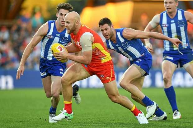 UNDER PRESSURE: Gold Coast Suns midfielder Gary Ablett attempts to avoid the North Melbourne Kangaroos defence.