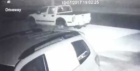 Screenshot of footage posted to Facebook shows the robbers scavenging through the vehicle.