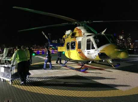The Toowoomba LifeFlight crew lands at Lady Cilento Children's Hospital with the 12-year-old boy.