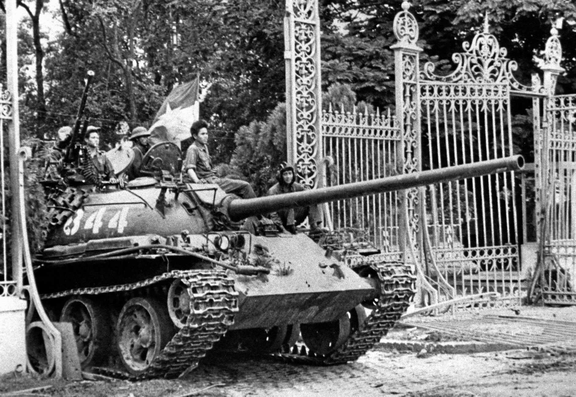 In this April 30, 1975 file photo, a North Vietnamese tank rolls through the gates of the Presidential Palace in Saigon, signifying the fall of South Vietnam. The war ended on April 30, 1975, with the fall of Saigon, now known as Ho Chi Minh City, to communist troops from the north. (AP Photo/File)