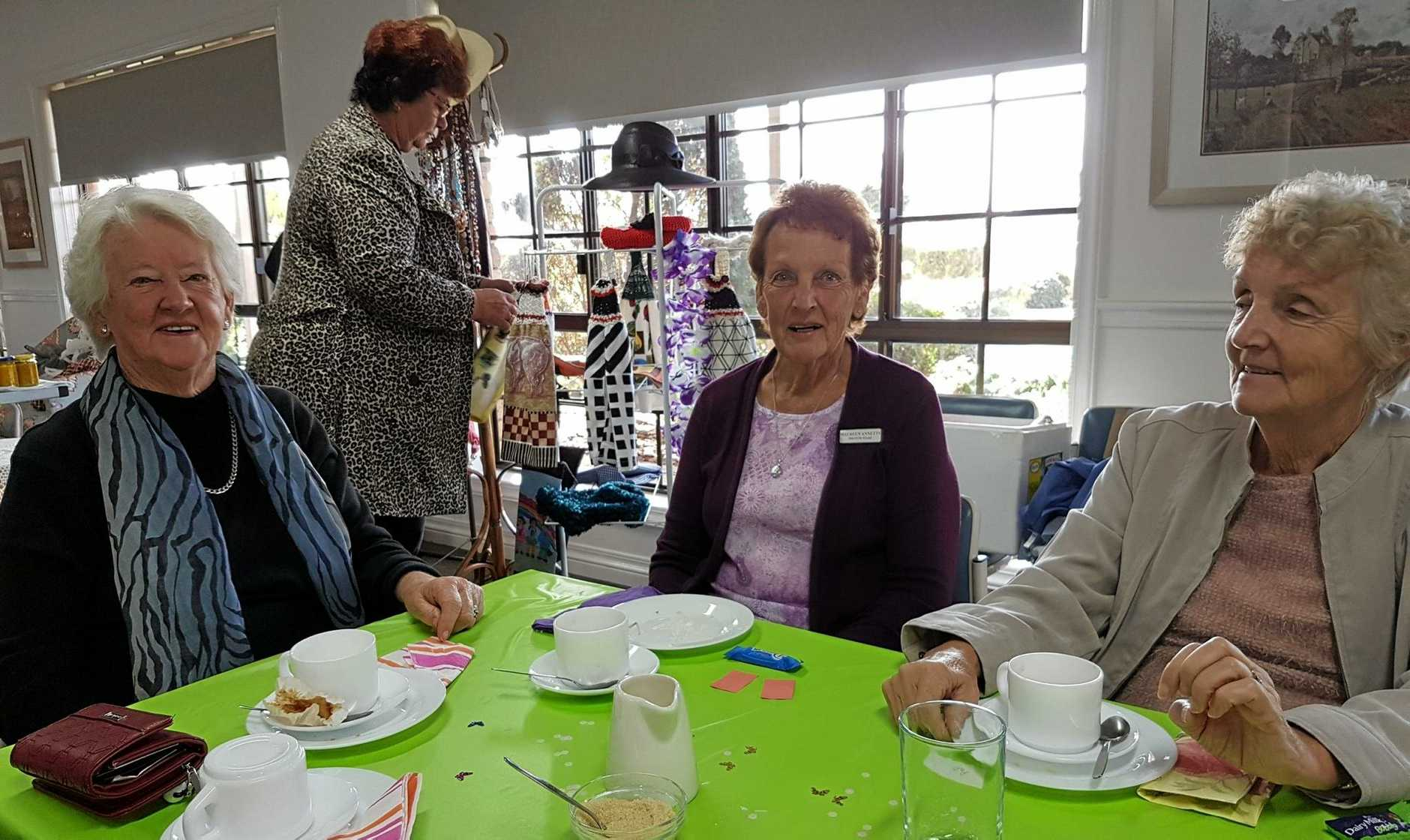 Drayton Villas residents enjoy morning tea and check out the goods at the bring-and-buy fundraiser.