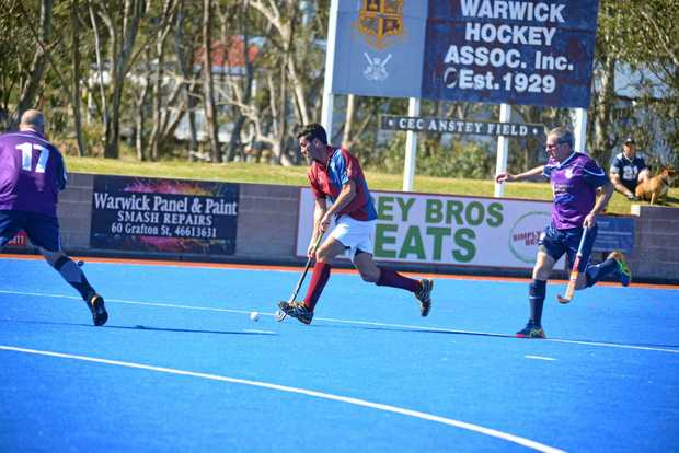 OPEN SPACE: Adam Byrne (with ball) is one of the Warwick players lining up in a state game at 5.30pm today at Queens Park.