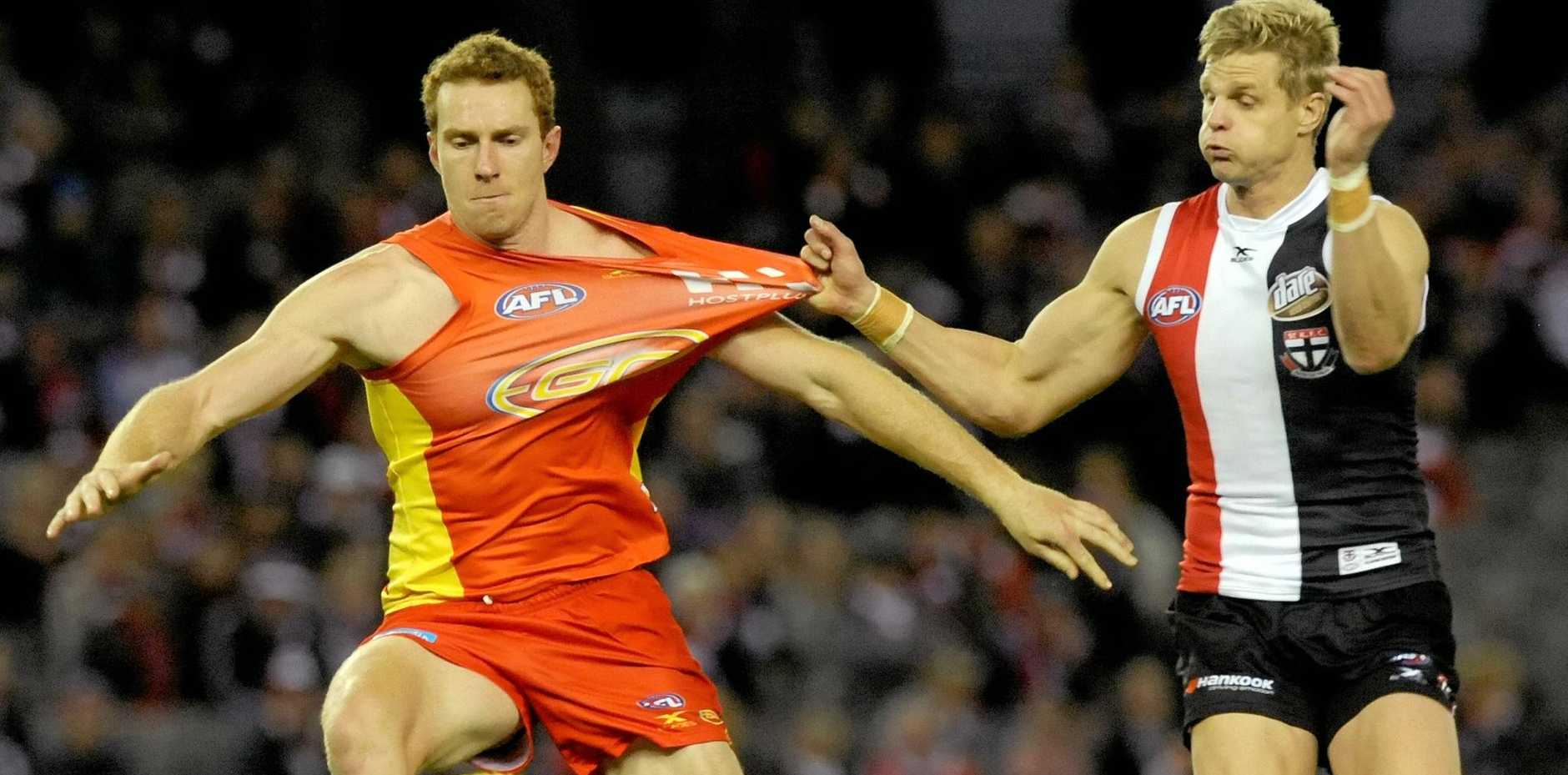 TOUGH ASK: Rory Thompson played his comeback match from injury against St Kilda's Nick Riewoldt.