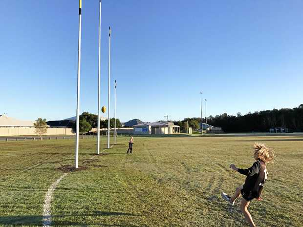 Noah and Violet Kimball test out the new new yellow and black tipped posts at Seabreeze Sportsfield, Pottsville.
