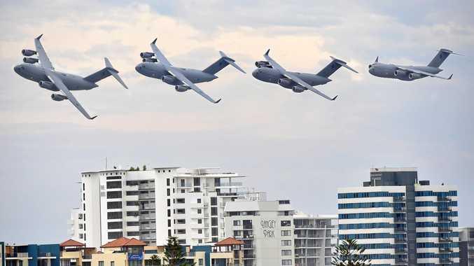 RAAF C-17A Globemasters doing a fly over.