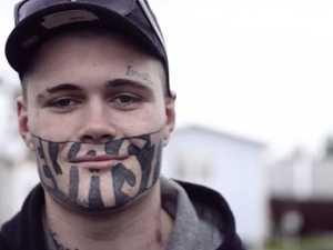 Drunk face tattoo holding Mark back