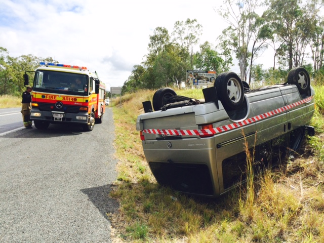 FLIPPED: A car has flipped onto its roof on the Bruce Hwy at Tannum Sands.