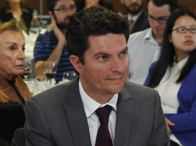 Federal Greens senators Scott Ludlam (left) and Larissa Waters listen to former Greens leader Christine Milne give her final address at the National Press Club in Canberra, Thursday, May 7, 2015. (AAP Image/Mick Tsikas)