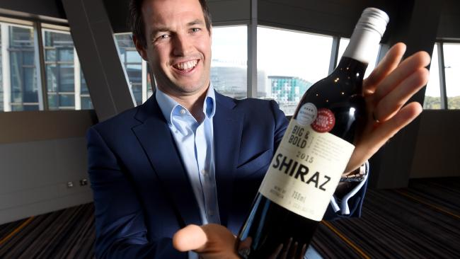 Coles Group wine buyer Ed Ashley holding last year's award-winning bottle. Photo: Sam Wundke