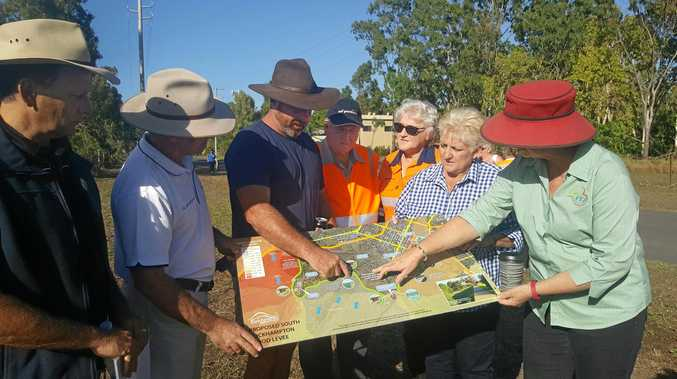 LEVEE FEARS: Port Curtis landholder Matthew Neale studies the levee plan with Capricornia MP, Michelle Landry, mayor Margaret Strelow and RRC councillors Tony Williams, Drew Wickerson, Neil Fisher and Rose Swadling.