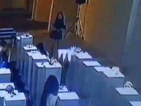 A woman allegedly destroyed hundreds of thousands of dollars worth of art after she caused an exhibit to fall like dominoes.