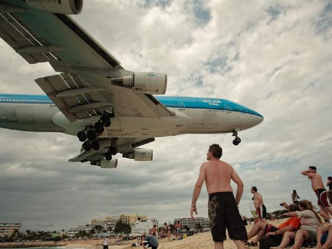 Tourists love getting up close to the jets that fly into Princess Juliana International Airport in St Maarten.