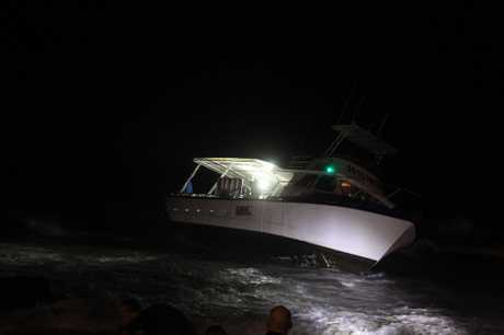 The vessel ran aground at Mooloolaba Beach about 11pm last night.