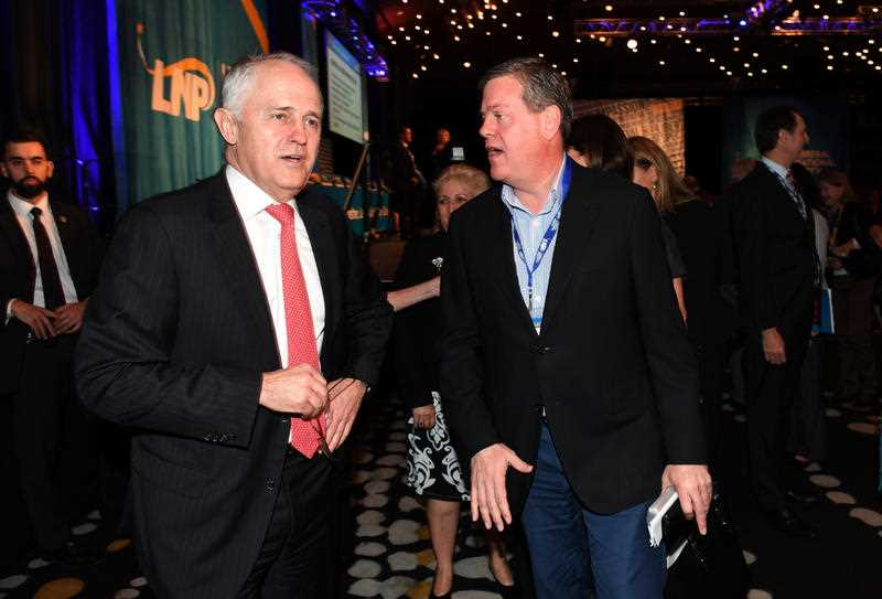 Australian Prime Minister Malcolm Turnbull (left) chats to the Queensland LNP leader Tim Nicholls at the Liberal National Party (LNP) state conference in Brisbane, Saturday, July 15, 2017.