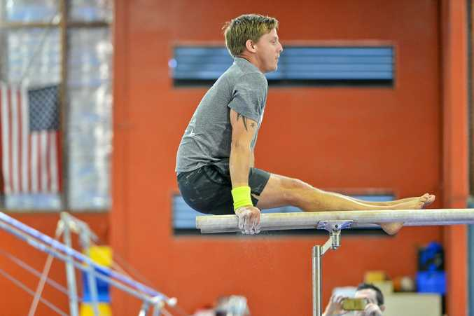 STRENGTH: Gladstone gymnast Brian Drever shows concentration and determination on the parallel bars.