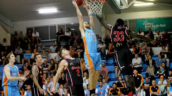 Mackay Meteors TJ Diop leaps into the air to stop a Cairns basket.