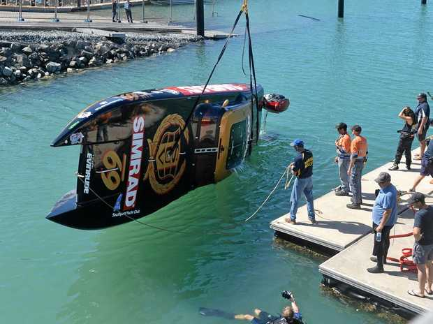 The SUV Simrad Supercat Extreme boat being craned in after flipping during the first round of the Offshore Superboat Championships, held at the Mackay Marina at the weekend.
