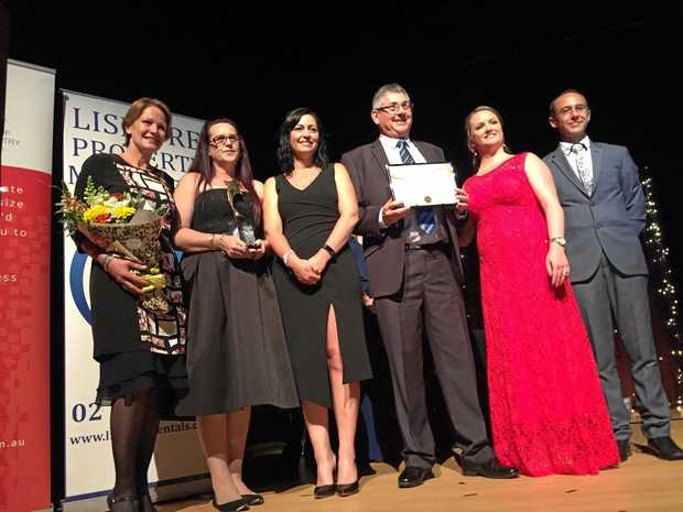 Winners of The Lismore Property Managers Business Excellence Awards, Summerland Credit Union. Graeme Herne, Kelly Burns, Christina Emilio and Vicki Hunter with Rachel and Rodney Jenkins of Lismore Property Managers.