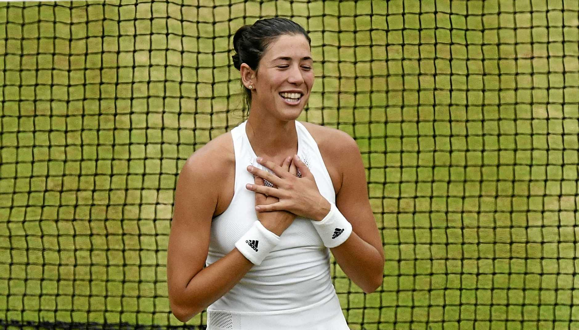 Spain's Garbine Muguruza celebrates after defeating Venus Williams of the United States in the Women's Singles final match on day twelve at the Wimbledon Tennis Championships in London Saturday, July 15, 2017. (Facundo Arrizabalaga/Pool Photo via AP)
