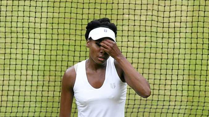 Venus Williams reacts during her loss to Garbine Muguruza in singles final at Wimbledon.