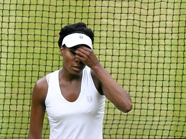Venus Williams reacts during her loss to Garbine Muguruza in singles final at Wimbledon.