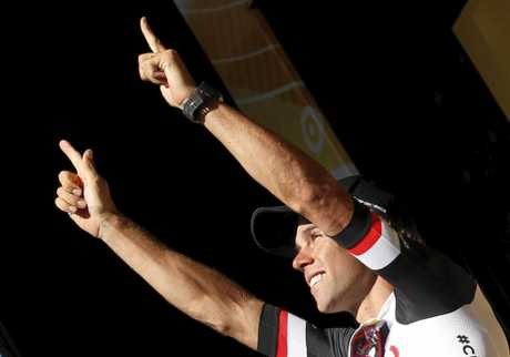 Australia's Michael Matthews celebrates on the podium after wining the 14th stage of the Tour de France.