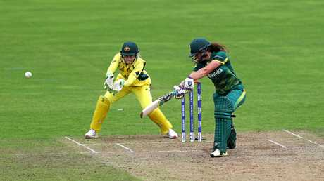 South Africa opener Laura Wolvaardt gets the ball away as Australia 'keeper Allysa Healy looks on during their World Cup match at Taunton.