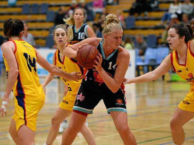 FOCUSE: Phoenix's Erica Carlson looks to shoot against the Capitals at Caloundra.