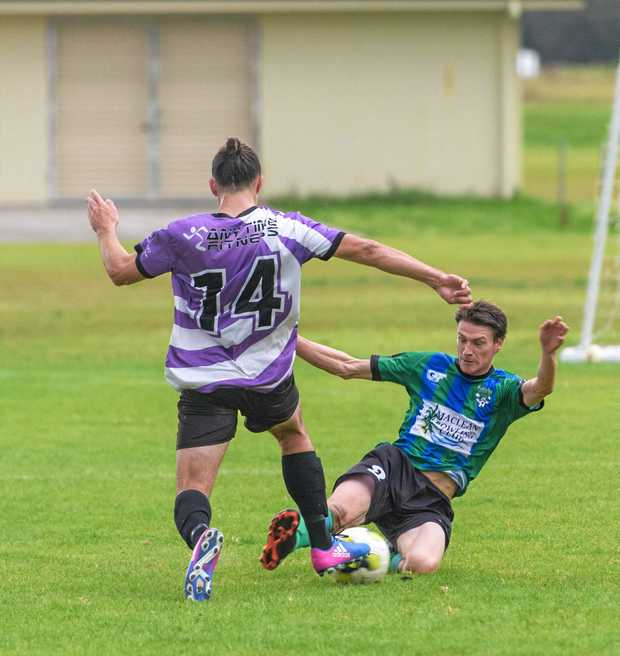 TIGHT TUSSLE: Action in the game between Maclean Bobcats and Grafton United at Barry Watts Oval.