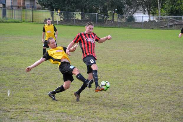 Alstonville striker Jacob Arthur and Goonellabah captain Matt Graham with some fancy footwork at Weston Park on Saturday.