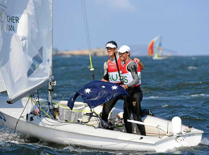 Mathew Belcher and Will Ryan have teamed up to win gold at the world 470 sailing titles in Greece.