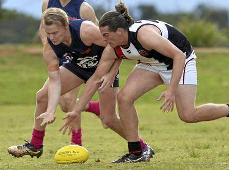 GROUND WORK: Coolaroo's Ray Riseley and South Burnett's Mitchell Francis battle for possession at Kratzke Oval.