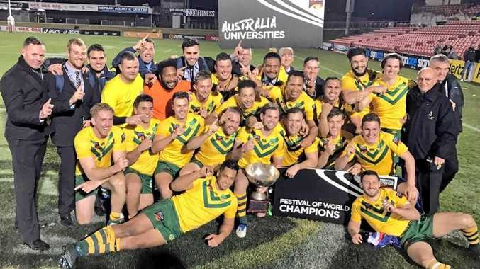 CHAMPIONS: The Australia squad celebrates victory in the final of the Universities Rugby League World Cup at Pepper Stadium, Penrith.