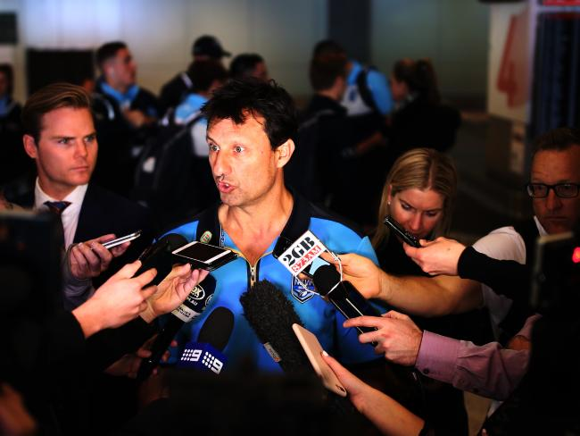 NRL Blues coach Laurie Daly talks at a press conference at Sydney airport after game three.