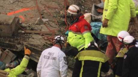 Rescue workers give the thumbs up after making contact with Stuart Diver beneath the rubble in 2007.