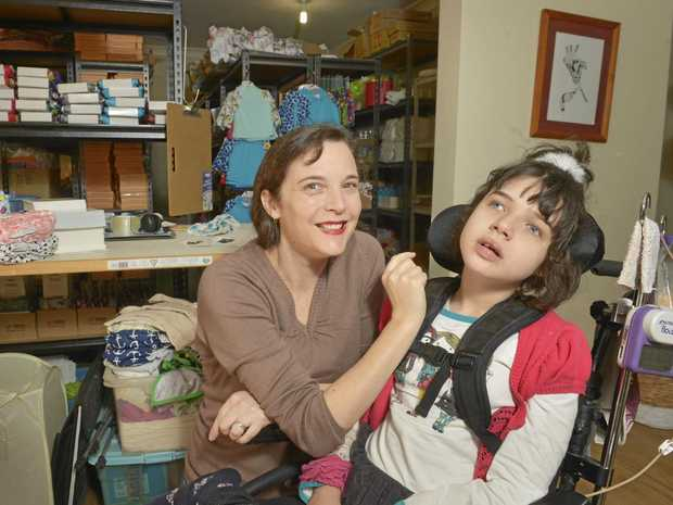 Tennille Graham runs her cloth nappy business Apikali from home while also caring for her daughter Abigail Graham, 12 who has a rare genetic disorder.