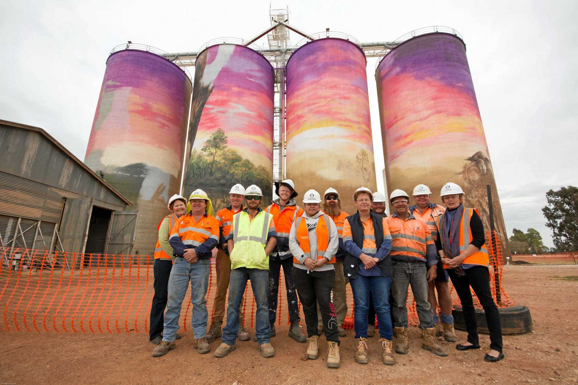 Shirley Southern (Thallon Progress Association vice-president) Darren Kelly (Grain Corp site manager), Travis Vinson (Drapl, artist) Michael Saunders, (back) Joel Fergie (The Zookeeper, artist) Casey Mitchell, Dion Mitchell (back), Cheryl Hill, Barry Morris (back) Colly Lasserre, Lenny Death, and Leanne Brosnan (Thallon Progress Association secretary).