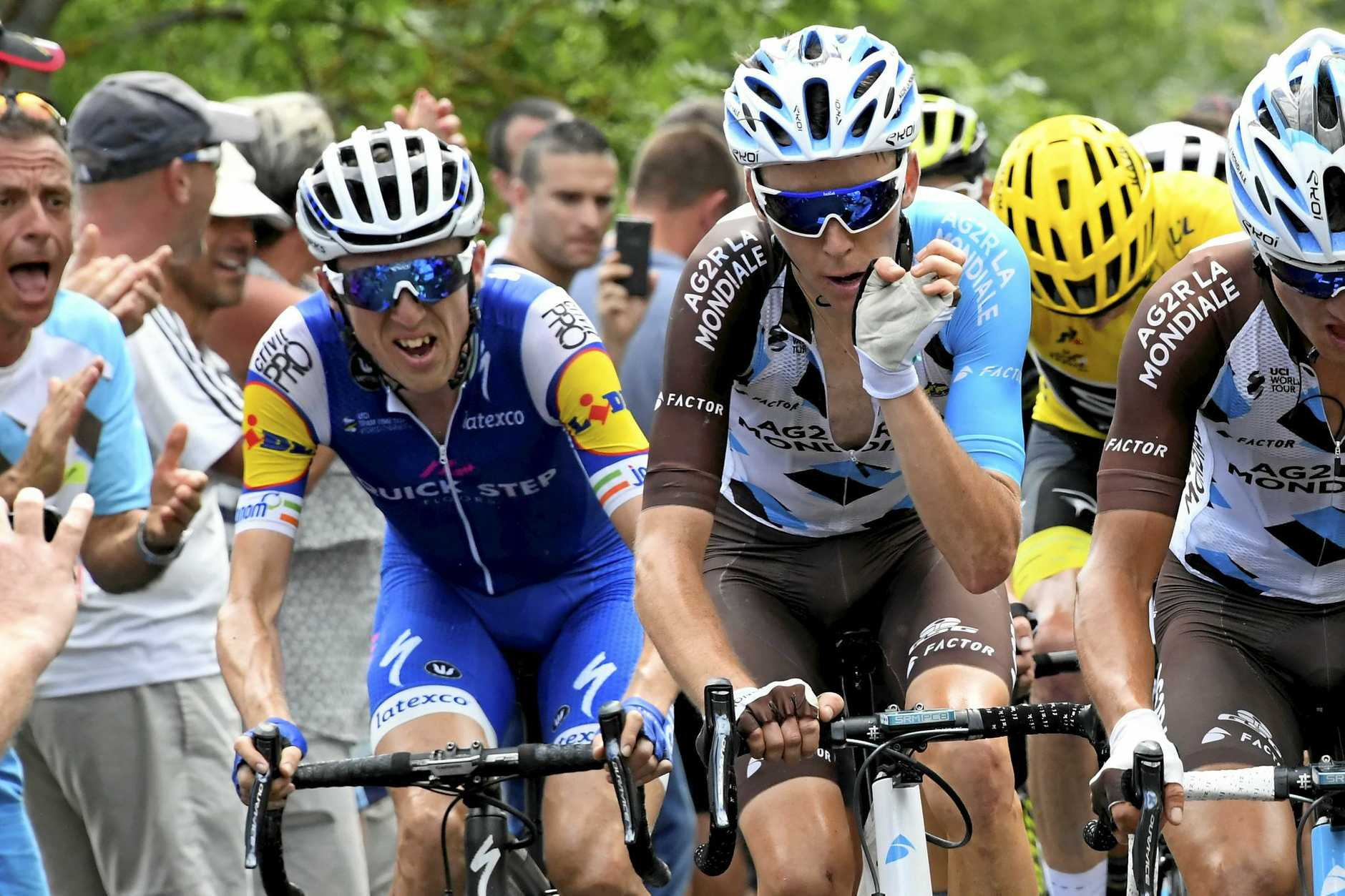 Ireland's Daniel Martin (left), France's Romain Bardet, and Britain's Chris Froome, wearing the overall leader's yellow jersey climb during the fifteenth stage of the Tour de France.