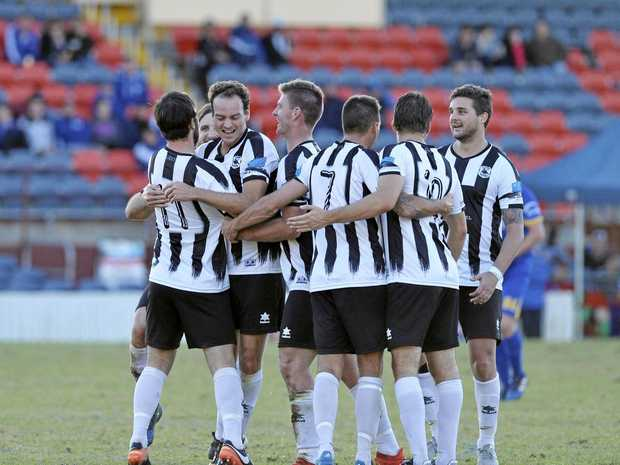 Willowburn celebrate against USQ FC in Toowoomba Football League men's President's Cup at Clive Berghofer Stadium, Sunday, June 4, 2017.