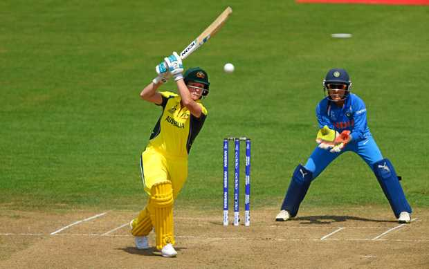CUP ACTION: Australia batsman Beth Mooney makes solid contact during her side's ICC Women's World Cup match against India.