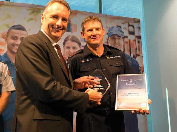Murgon's Cameron Bond (right) accepts his Everyday Hero award.