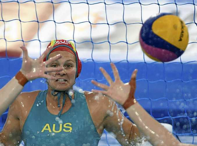 FOCUS: Australian goalkeeper Lea Yanitsas peers through a forest of arms during Australia's win over Kazakhstan in the women's world water polo championships in  in Budapest, Hungary.