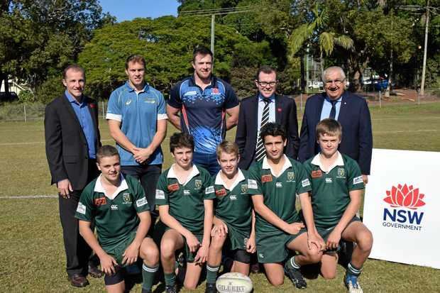 Stephen Hoiles and Jed Holloway with Lismore rugby juniors, promoting the Classic Wallabies and Barbarians rugby game that will be played at Crozier Field in October.