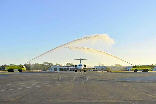 An Alliance Airlines Fokker 70 touches down for the first time at Gladstone Airport after the departure of Virgin Australia's service to Brisbane.